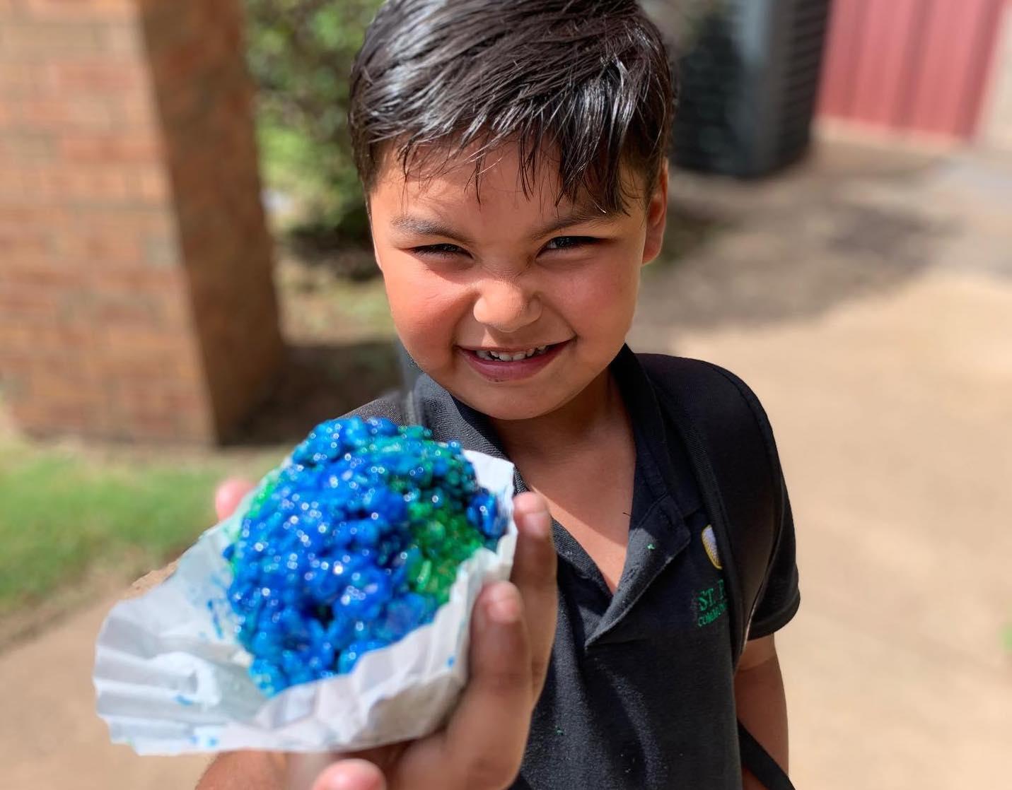 boy holding rice crispy globe