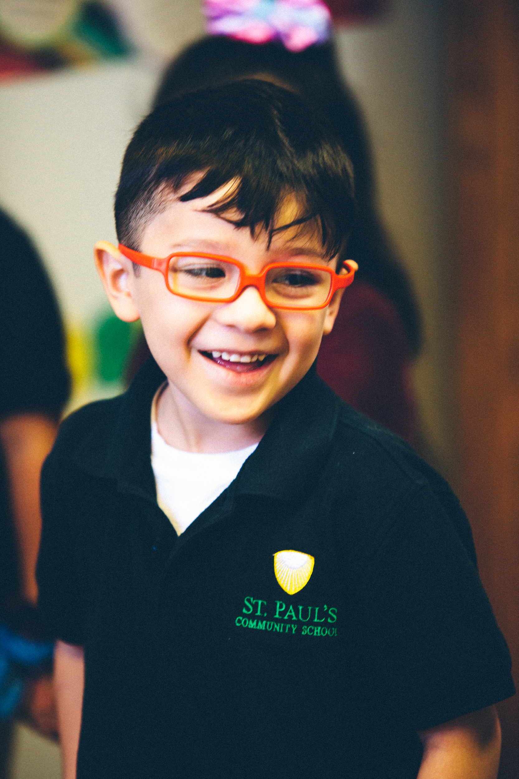 little boy with orange glasses